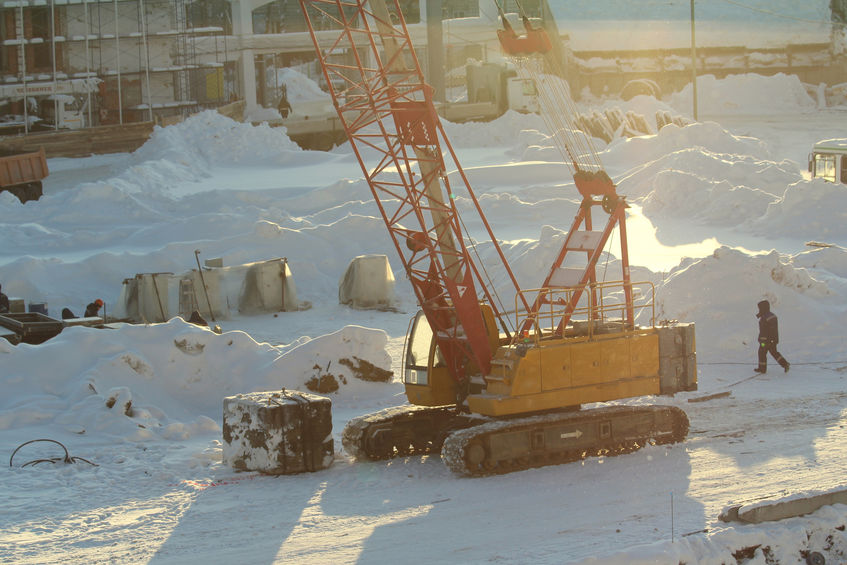 Large Crane Working On Winter Day